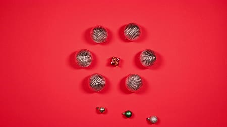 Stop motion animation of New Years balls and gift. Flat lay of Christmas balls in the form circle. Top view Vídeos