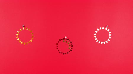Stop motion animation of New Years confetti balls, flat lay. Concept of Christmas and holiday, sale. Copy space Stock mozgókép