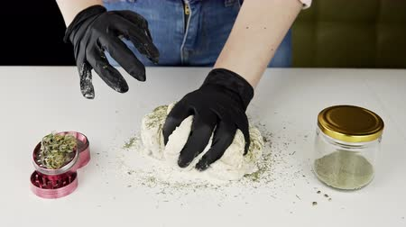Preparing to cooking hemp cake or bread. Close-up of fresh dough with cannabis flour. Concept of uses marijuana in a food industry Vídeos