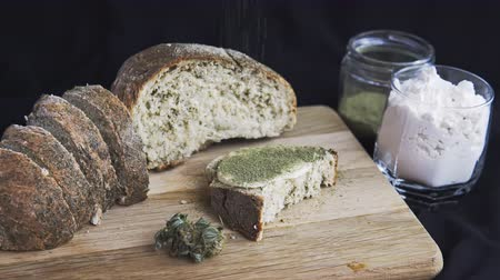 Close-up of bread with hemp flour, sandwich with cannabis butter and hashish. Concept of using marijuana in the food industry Stockvideo