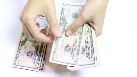 fornada : Slowmo video of female hands counting money on white, cash fifty dollar bills close up