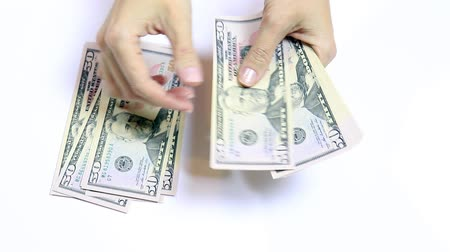 Female hands counting money on white, cash fifty dollar bills close up