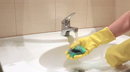 disinfectant : Unrecognizable woman in yellow rubber gloves. Cleaning and washing concept Stock Footage
