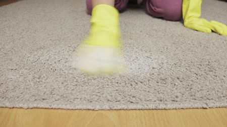 halı : Woman in yellow rubber gloves cleaning carpet with a sponge and foam Stok Video