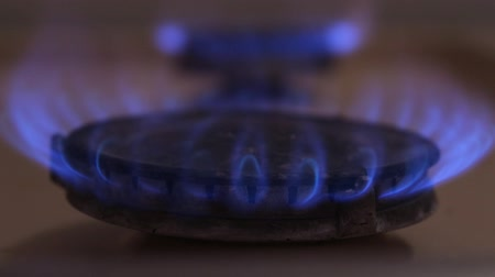 gas hob : A person burning gas with a piezo lighter on a kitchen stove Stock Footage