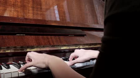 půltón : Hands of caucasian woman playing piano, close up, side view