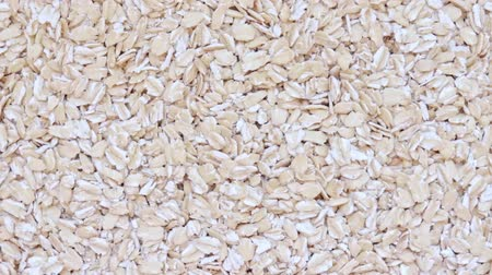 oat flakes : Raw oat flakes texture, healthy porridge rotation background, copy space