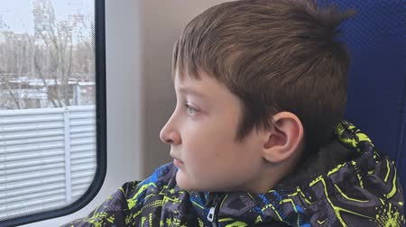 outsider : Portrait of a lonely sad, depressed and apathetic preteen boy riding on a train, he escaping from home
