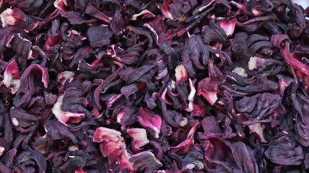 hibiscus tea : Dry hibiscus flowers tea rotation texture background from Sudanese rose, karkade