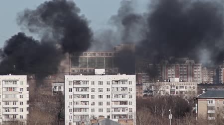 sky bomb : Urban landscape, fire and a lot of black smoke goes out of buildings, houses in the city, aerial view