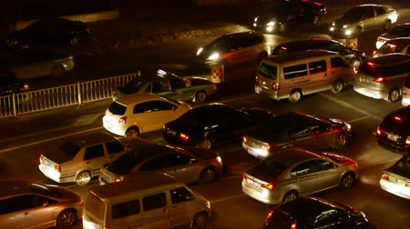 életmód : Many cars on road,traffic jam at night.