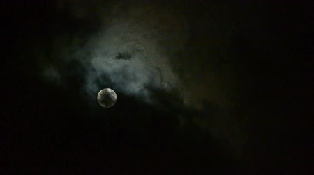 celestial : move full moon through cloudy,night flight over clouds and smoke,mystery fairyland scene.