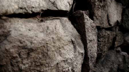 blemished : stone wall and winding lane in mountain. Stock Footage
