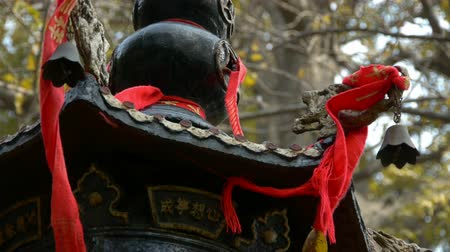 buddhista : Dragon and metal bell on censer tower,Red ribbon blowing in wind,Trees,shade. Stock mozgókép
