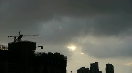 marco internacional : Clouds cover sun sky,building high-rise,House silhouette. Stock Footage