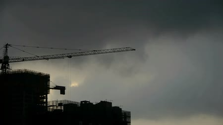 marco internacional : Dark clouds cover sun sky,building high-rise,House silhouette.