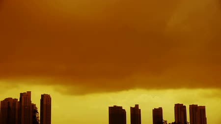 marco nacional : Dark clouds cover sun sky,building high-rise,House silhouette.