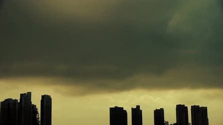 müteahhit : Dark clouds cover sun sky,building high-rise,House silhouette.
