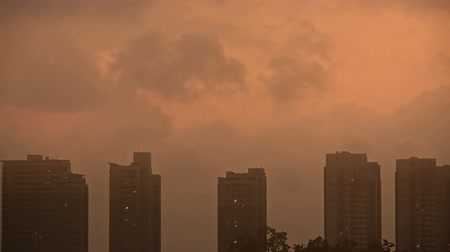 marco internacional : Sandstorm,Dark clouds cover sky at evening,building high-rise,House silhouette,sunrise,sunset,fog.