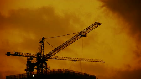 evening sun : Dark clouds cover sky at evening,building high-rise,House silhouette. Stock Footage