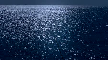 donanma : Sparkling water surface and fishing rod,horizon,skyline,night.