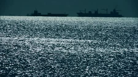 sparkling drink : Sparkling water surface and Vessel Ship,horizon,skyline,night. Stock Footage