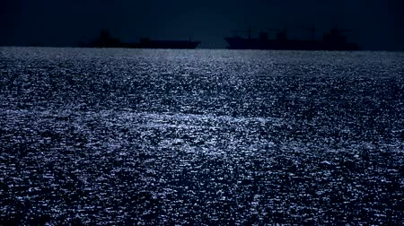 night scene : Sparkling water surface and Vessel Ship,horizon,skyline,night. Stock Footage