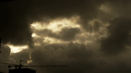marco nacional : Dark clouds cover sky,Cranes,building high-rise,House silhouette. Stock Footage