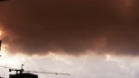 marco internacional : Dark clouds cover sky,Cranes,building high-rise,House silhouette. Stock Footage