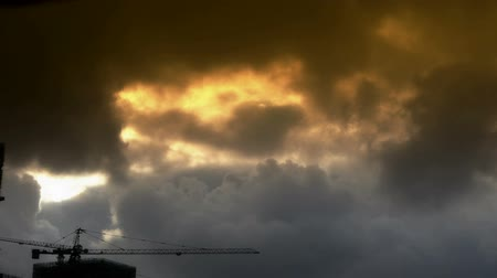vállalkozó : Dark clouds cover sky,Cranes,building high-rise,House silhouette. Stock mozgókép