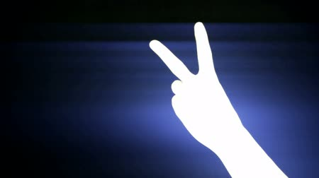 sayma : Count from one to five,hand sign silhouette and rays lights,tech computer background.