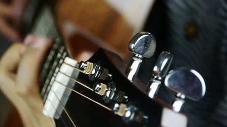 loud music : playing guitar,strum. Stock Footage