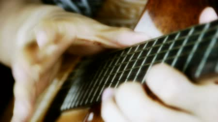 roll up : playing guitar,strum. Stock Footage