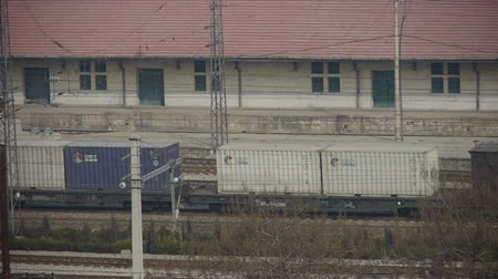 demiryolu : Long goods train traveling on railway,After railway station.