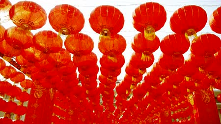 chinese culture : Red lanterns tassel swaying in wind,elements of East,china new year.