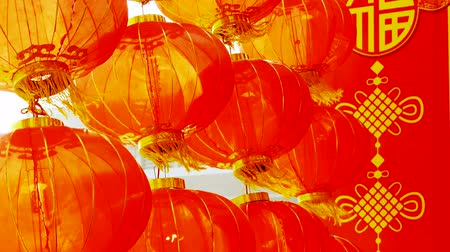 feliz ano novo : Red lanterns tassel swaying in wind,elements of East,china new year.