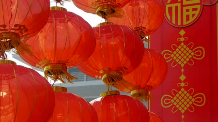 şanslı : Red lanterns tassel swaying in wind,elements of East,china new year.