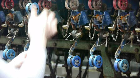 kumaş : Reeling machine and Textile-machine in operation.Workers reeling at workshop.