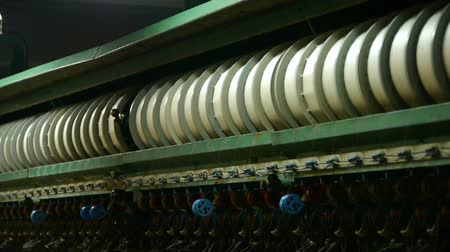 farm equipment : Reeling machine and Textile machine in operation.