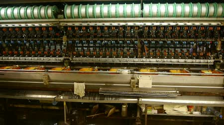 silkworm : Reeling machine and Textile machine in operation.