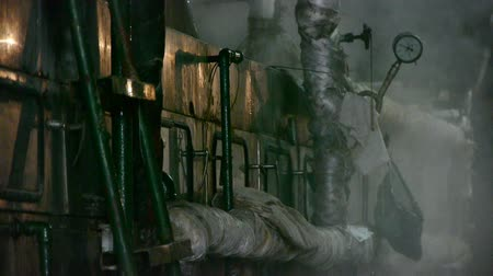 silkworm : Factory filled with steam.dim light,Valve,Pipeline,Boiler. Stock Footage