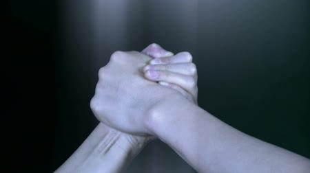 contender : Two people in hand wrestling game. Stock Footage