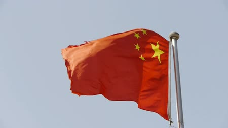 clipping path : Chinese flag flutters in wind.