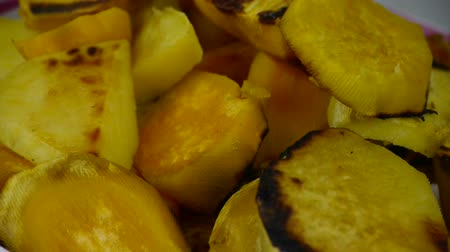 halve : Rotation of delicious fried sweet potatoes. Stock Footage