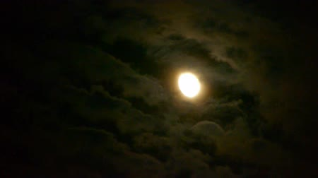 fullmoon : Full moon through cloudy,night flight over clouds,mystery fairyland scene.