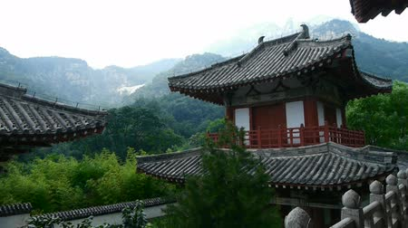 tourism : China ancient temple architecture in forest,bamboo mountain hill.