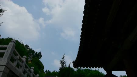 altocumulus : High clouds and temple roof,flowing clouds.
