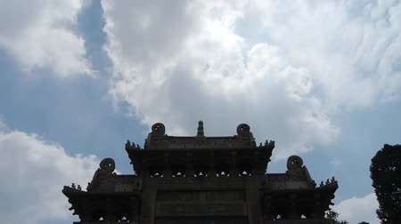 chrámy : China stone arch building & ancient city gate.movement of clouds.