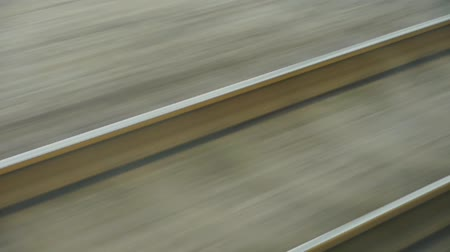 trilho : Speeding train travel,scenery outside window.train-station rail.