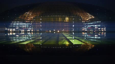 křivky : BeiJing China National Grand Theatre in reflection in lake water at evening night.ornate modern architecture,metropolis sci-fi fantasy style. Dostupné videozáznamy